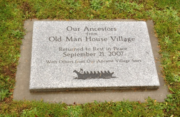 Memorial plaque honoring the 11 human remains that had been discovered near the Old Man House Village and held for many years at the Burke Museum. Pursuant to the Native American Graves Protection and Repatriation Act, the remains were reburied at Suquamish Cemetery in 2007.