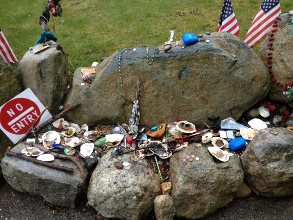 Tributes left along the stone wall by Chief Seattle's grave.